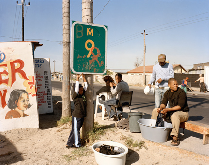 At Kevin Kwanele's Takwaito Barber, Lansdowne Road, Khayelitsha, Cape Town, in the time of AIDS, 16 May 2007. Courtesy New Museum